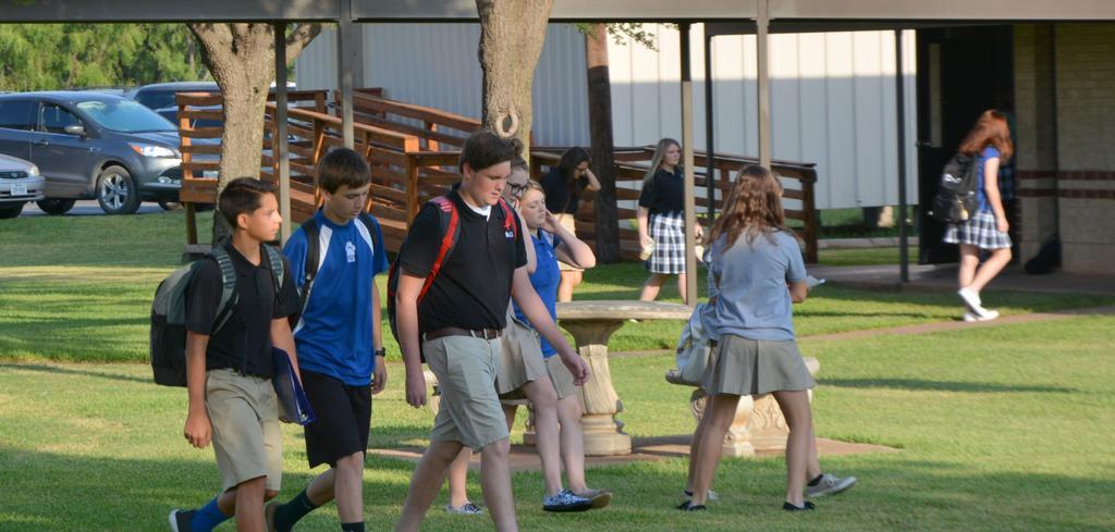 middle school kids walking across campus