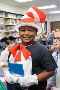 Boy with Dr Suess costume and book