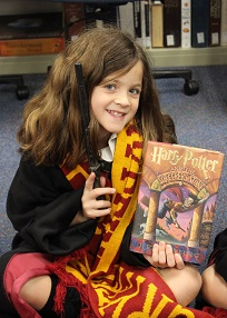 Girl with Harry Potter book