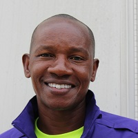 Coach Arthemon Sindayigaya, ACS Track and Cross Country Coach